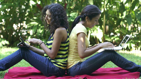 Two young women using the internet Stock Video Footage