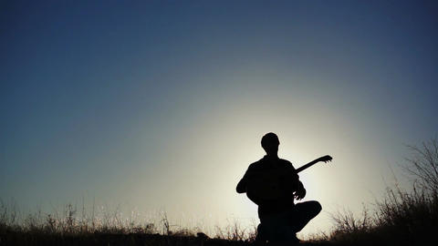 Silhouette Guitar in Air Achievement Stock Video Footage