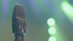 Close-up of microphone on stage under the rays of spotlights Footage