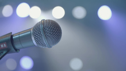 A microphone on stage. Close-up Footage