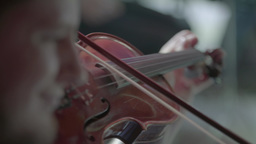 The violin in his hands while playing music Footage