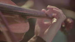 Hands of a violinist on the strings while playing the violin (close up) Footage