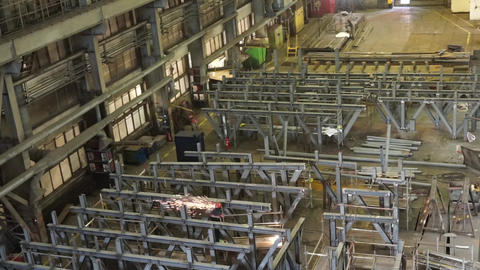 Workers work in the shipbuilding hall. Heavy Industry Live Action