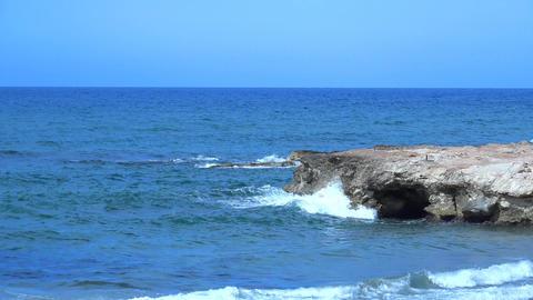 Waves Beating Against The Rocks. 4K Footage