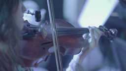 Girl playing the violin. Close-up Footage