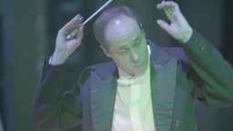 Conductor with baton in hand conducting the orchestra Footage