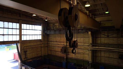 Heavy industry. Shipyard hall. Overhead crane hook is going down Footage