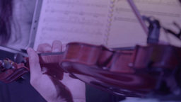 Playing the violin on the background of the music stand with the notes Footage