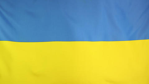 Textile flag of Ukraine in slow motion Footage