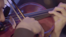 Playing the violin. Close-up. The bow plays the strings Footage