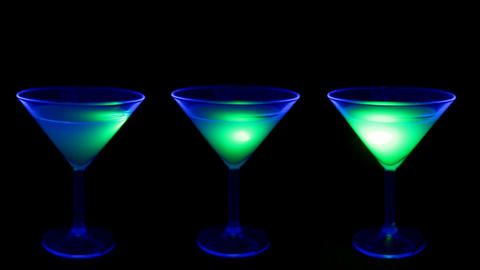 Cocktail in a club with UV light Footage