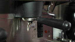 making espresso coffee in espresso machine at restaurant, slider shot Footage