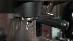 making espresso coffee in espresso machine at restaurant, slider shot Footage