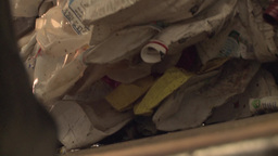 waste for recycling purposes being loaded in recycling center Footage