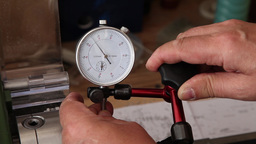man using micrometer clock precision comparator dial test indicator Footage