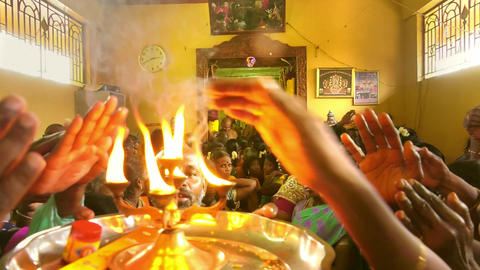 Hindu people making Puja to pray for God at Murugan Temple Live Action