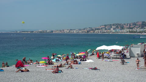 People on Nice beach in France Live Action