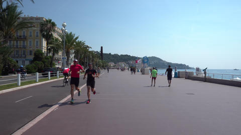 People on the Promenade des Anglais in Nice Live Action
