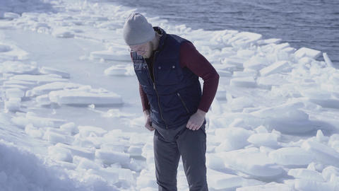 Young handsome man geologist searched something in cold ice snowing glacier Footage
