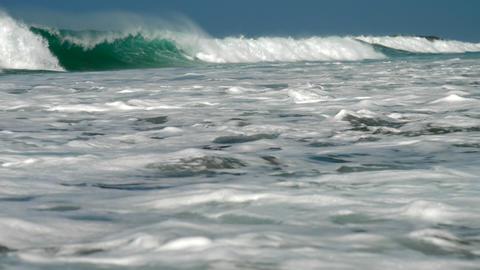 huge ocean waves flow under blue sky with white foam Footage