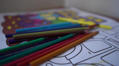 Colored pencils are on the children's coloring with cars Live Action