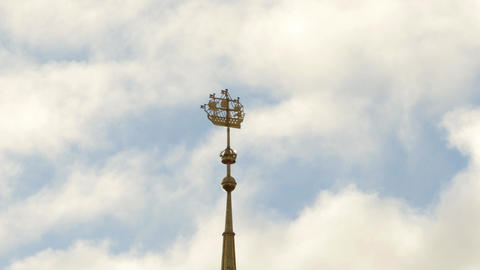 Beautiful gilded weather vane shaped as big sailing ship on cloudy windy day Footage