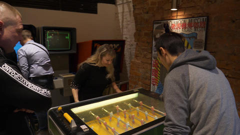 Museum of old fashioned slot machines where people are playing foosball Footage