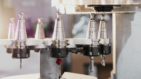 Automatic change of milling heads in modern CNC machining center Footage