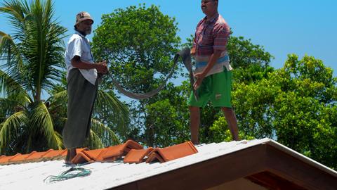 African Americans put brown tile on modern building Footage