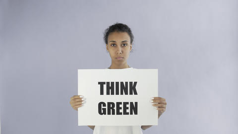 Afro-American Girl Activist With Think Green Poster on grey background Live Action