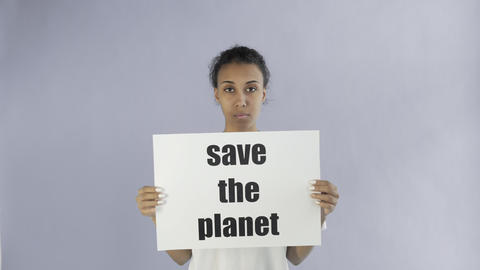 Afro-American Girl Activist With Save The Planet Poster on grey background Live Action