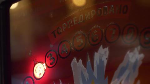 Orange glass panel of slot machine with flashing symbols, words and digits Footage
