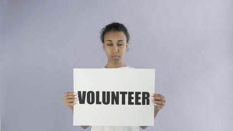Afro-American Girl Activist With Volunteer Poster on grey background Live Action