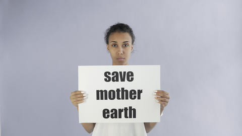 Afro-American Girl Activist With Save Mother Earth Poster on grey background Live Action
