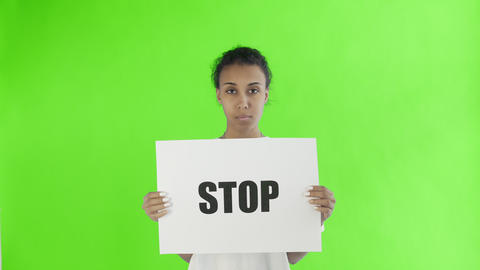 Afro-American Girl Activist With Stop Poster on chroma key background Live Action