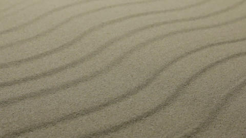 Sand textures. Dune lines and waves in the sand. With space Footage