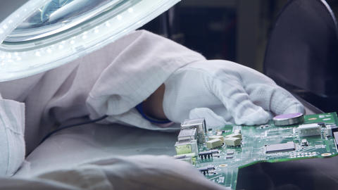 Close up of Manual soldering of electronic components on a board Footage