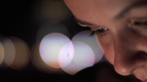 concentrated young lady with natural makeup at bright bokeh Footage