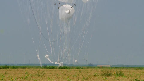 Cargo parachuting large heavy loads, landing cargo with brake parachutes in the field Live Action