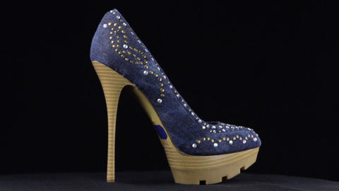 Rotation, shoes with high heels. Denim with rhinestones high heel shoes on black Live Action