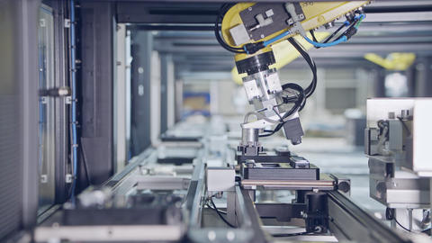 Advanced robots placing parts in an automated assembly line Live Action