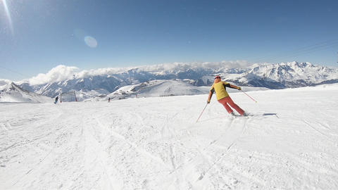 Professional Skier Skiing On Sunny Winter Day - Slow motion Footage