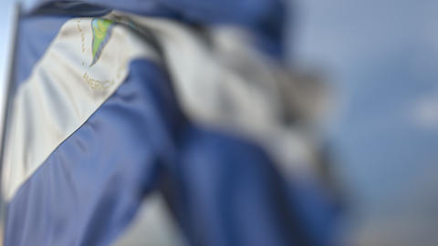 Waving flag of Nicaragua, shallow focus close-up. Realistic loopable 3D Footage
