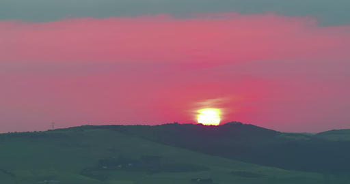 sunset scene with sun fall behind the clouds and... Stock Video Footage