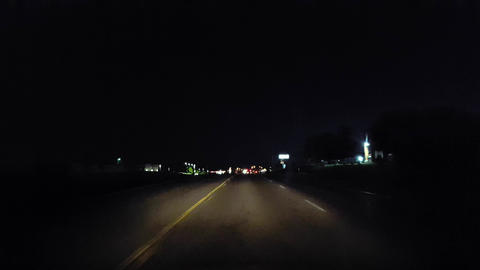 Driving City Street During the Evening. Driver Point of View POV Urban Road at Night Footage