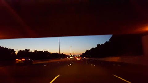 Driving City Highway During the Evening. Driver Point of View POV Urban Interstate at Night. Freeway Footage