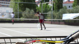 tennis court with people playing tennis, slider shot Footage