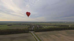 Hot air balloon in the sky over a field.Aerial view Footage