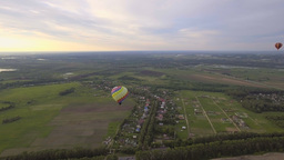 Hot air balloons in the sky over a field.Aerial view Footage