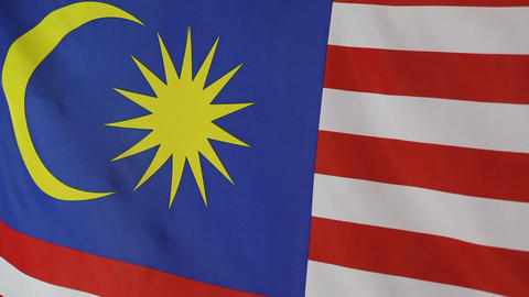 Closeup of a textile flag of Malaysia in slow motion Live Action